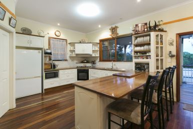 The huge kitchen with timber benchtops.