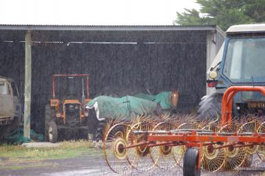 Smart horse - in the machinery shed out of the rain!