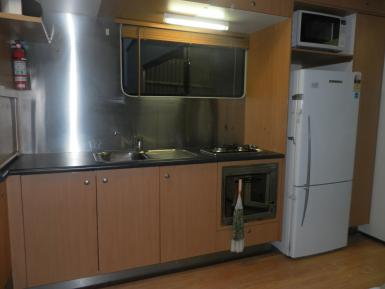 Fisher and Paykel fridge, Smeg oven, 2 burner gas cooktop.