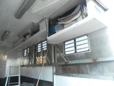 Overhead storage on struts