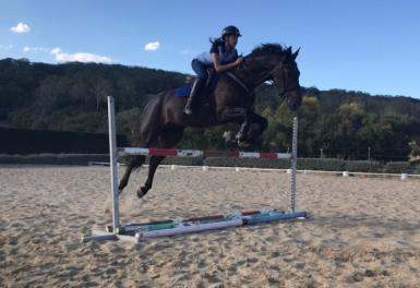 My 13 yr old daughter having a jump